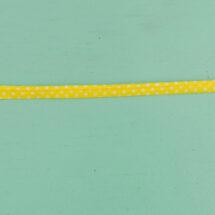 Passepoil à pois jaune 10 mm gros plan